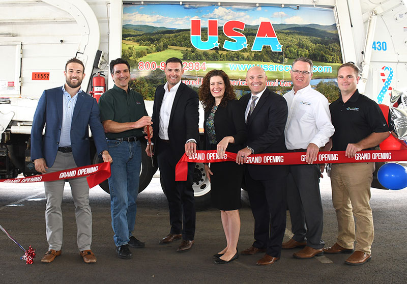 Gathering to celebrate the grand opening of the Shoham Road natural gas fueling station: (l to r) Matt Antonacci, John Maulucci, and Frank M. Antonacci of USA Hauling and Recycling; Commissioner Katie Dykes, CT DEEP; Mark Riley from Clean Energy; Timothy Schneider and Samuel Schneider of Earthlight Solar.